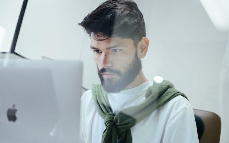 a man looking at a computer screen
