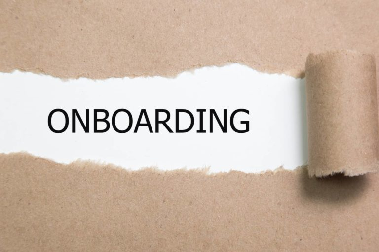 paper ripping and revealing the word Onboarding