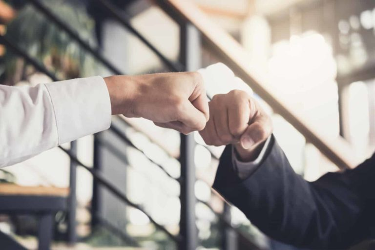 fist bumping in a corporate setting