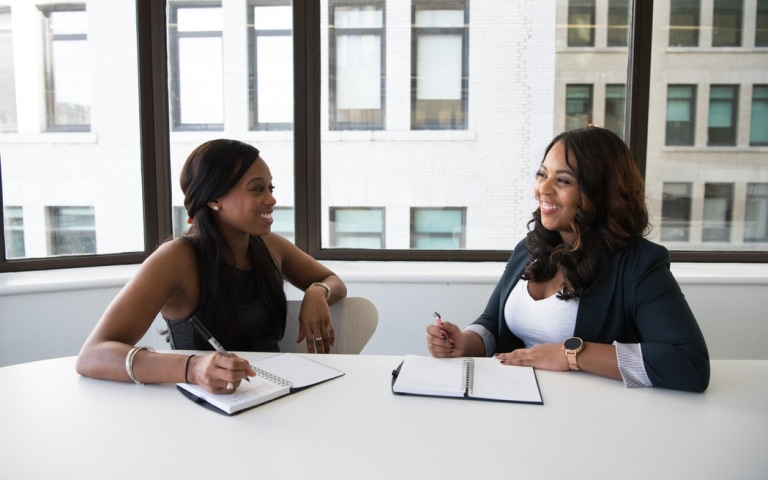 women meeting at a table in an office